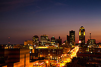 Dusk on a summer night in Des Moines, Iowa with Grand Avenue leading toward the downtown district
