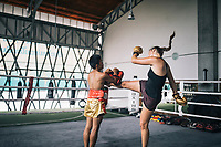 Chiang Mai, Thailand -- May 20, 2017: Thays Runge, a German traveler, sparring at the Chiangmai Muay Thai Training Center in northern Thailand.