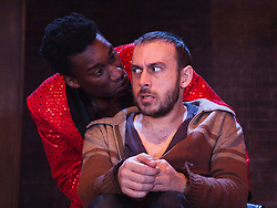 """© Licensed to London News Pictures. 30/01/2012. London, England. L-R: Nathan Stewart-Jarrett and Chris New performing. """"The Pitchfork Disney"""", a searing, disturbing vision of fear, sexuality and the effects of random violence written by Philip Ridley opens at the Arcola Theatre, Hackney. Directed by Edward Dick. Photo credit: Bettina Strenske/LNP"""