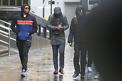 Ramani Boreland, centre, arrives at Highbury Corner Magistrates Court accompanied by masked supporters where he alongside rising drill music rapper UnknownT - real name Daniel Lena are appearing on charges of the murder of of Steven Narvaez-Jara, 20, on New Year's Day last year, alongside Mohammed Mussa who is charged with violent disorder.