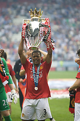 WIGAN, ENGLAND - Sunday, May 11, 2008: Manchester United's Patrice Evra celebrates after winning the Premier League for the 10th time after the final Premiership match of the season at the JJB Stadium. (Photo by David Rawcliffe/Propaganda)