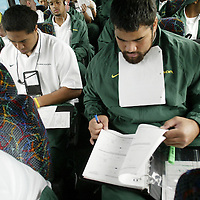 Oregon Ducks football team prepares for trip and travels to Oklahoma for game against against the Sooners..Players take written tests on bus and plane to Oklahoma about schemes and Oklahoma history that will be handed in to their coaches...Photos © Todd Bigelow/Aurora