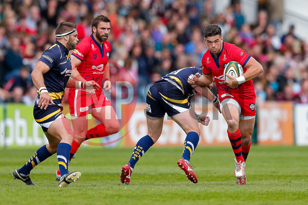 Bristol Rugby Inside Centre Ben Mosses is challenged by Worcester Number 8 GJ van Velze (capt) - Photo mandatory by-line: Rogan Thomson/JMP - 07966 386802 - 25/04/2015 - SPORT - Rugby Union - Worcester, England - Sixways Stadium - Worcester Warriors v Bristol Rugby - Greene King IPA Championship.