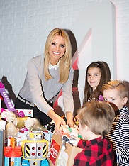 OCT 01 2014 Tess Daly with Argos Argos Toy Exchange campaign