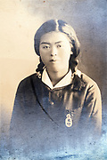 oxidizing photo portrait of a young adult Japanese woman in school uniform