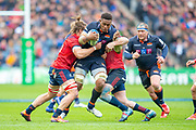 Viliame Mata (#8) of Edinburgh Rugby charges at the Munster defence during the Heineken Champions Cup quarter-final match between Edinburgh Rugby and Munster Rugby at BT Murrayfield Stadium, Edinburgh, Scotland on 30 March 2019.