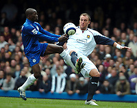 Photo: Ed Godden.<br />Chelsea v West Ham United. The Barclays Premiership. 09/04/2006. Claude Makalele (L) and West Ham's Dean Ashton clash together.