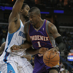 03 December 2008:  Phoenix Suns forward Amare Stoudemire (1) is defended by New Orleans Hornets center Hilton Armstrong (12) during a 104-91 victory by the New Orleans Hornets over the Phoenix Suns at the New Orleans Arena in New Orleans, LA..
