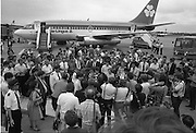 1983-15-08.15th August 1983.15-08-1983.08-15-83..Pressed:..Photographed at Dublin Airport..Gold medalist Eamonn Coughlan geeeted by press and supporters on the tarmac of Dublin Airport on his return from the World Athletic Championships in Finland. His wife Yvonne and chldren Suzanne (four) and Eamonn Jn (two) are with him. Suzanne is in his arms while his wife holds Eamonn Jn. His mother Kathleen is beside Yvonne..