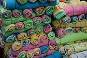 Roles of cotton towels sold at an open market in Geylang, Singapore