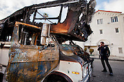 A burned-out van is called in for towing by Sergeant Steve Muirhead. Jan. 30, 2011. Los Angeles, Calif. (photo by Gabriel Romero ©2011)