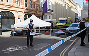 UNITED KINGDOM, London: 21 June 2018 <br /> The body of a man thought to have died from a heart attack lays on the floor in Mayfair, Central London this evening. Dozens of police and ambulance crews were quick to arrive and have cordoned off Albermarle Street.<br /> Rick Findler