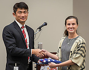 Brooke Baguettes, right, presents a flag on behalf of Representative John Culberson to ChaoLin Chang, left, during the dedication and ribbon cutting for the Mandarin Immersion Magnet School, October 24, 2016.