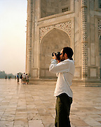 Man photographing at the Taj Mahal, India