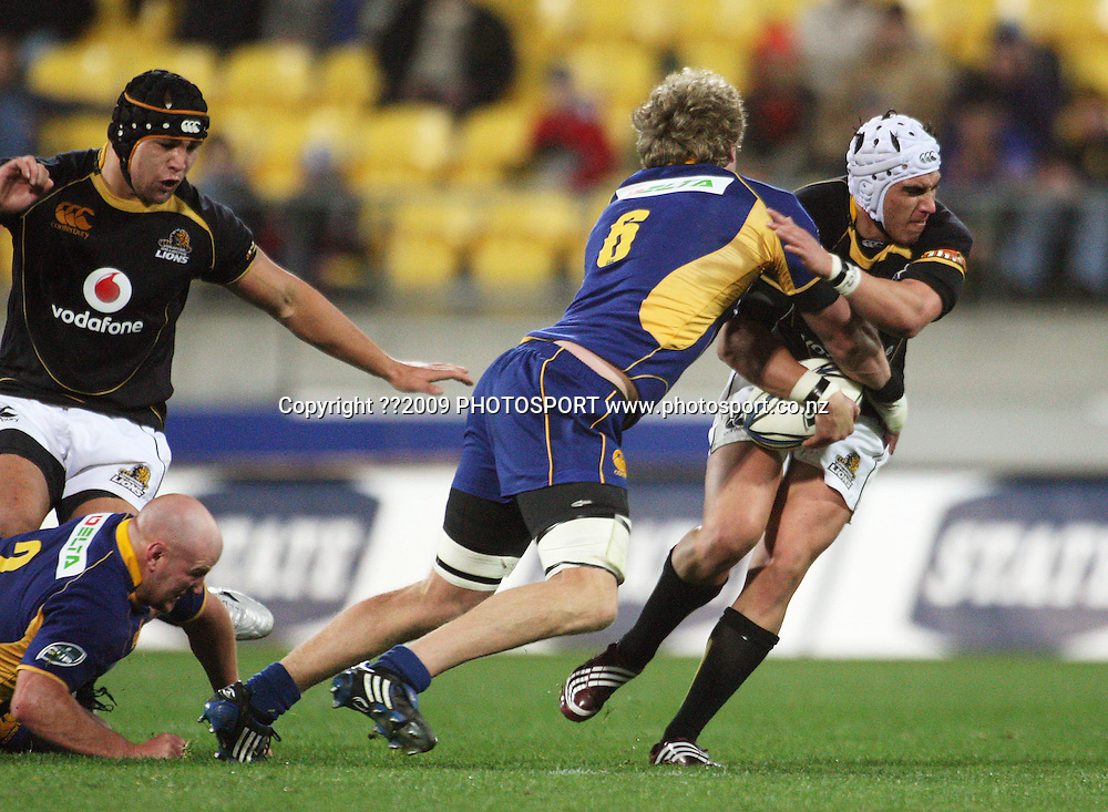 Otago flanker Adam Thomson tackles Wellington first five Daniel kirkpatrick.<br /> Air NZ Cup Ranfurly Shield match - Wellington Lions v Otago at Westpac Stadium, Wellington, New Zealand. Friday, 31 July 2009. Photo: Dave Lintott/PHOTOSPORT