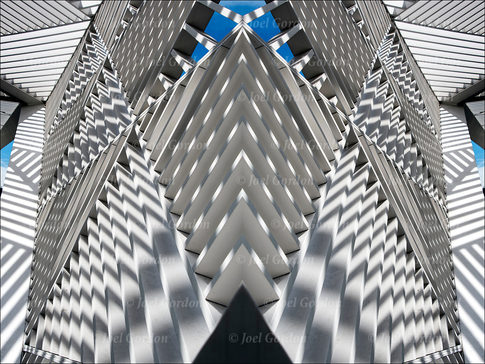 Shadows patterns and shapes from the sun directly above on the white canopy lattice sculpture.<br />
