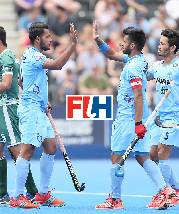 LONDON, ENGLAND - JUNE 24: Harmanpreet Singh of India celebrates scoring their teams fifth goal with teammates during the 5th-8th place match between Pakistan and India on day eight of the Hero Hockey World League Semi-Final at Lee Valley Hockey and Tennis Centre on June 24, 2017 in London, England. (Photo by Alex Morton/Getty Images)