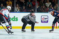 KELOWNA, BC - DECEMBER 27:  Line official Cody Wanner stands at the face-off to drop the puck between Jadon Joseph #18 of the Kelowna Rockets and Caedan Bankier #14 of the Kamloops Blazers at Prospera Place on December 27, 2019 in Kelowna, Canada. (Photo by Marissa Baecker/Shoot the Breeze)