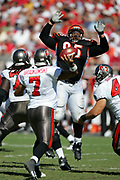TAMPA, FL - OCTOBER 15:  Defensive tackle Sam Adams #95 of the Cincinnati Bengals jumps high in the air while trying to block a pass by quarterback Bruce Gradkowski #7 of the Tampa Bay Buccaneers at Raymond James Stadium on October 15, 2006 in Tampa, Florida. The Bucs defeated the Bengals 14-13. (©Paul Anthony Spinelli) *** Local Caption *** Sam Adams;Bruce Gradkowski