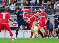 Photo: Leigh Quinnell.<br /> Leyton Orient v Swansea City. Coca Cola League 1. 06/10/ Swanseas Jason Scotland at the middle of a battle with Orients Sean Thornton.