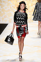 Yulia Saparniyazova (Women Direct) walks Desigual Fall 2014