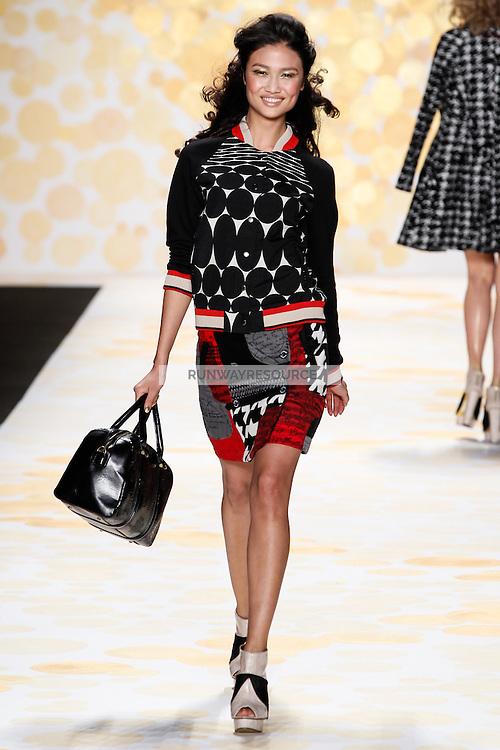 Yulia Saparniyazova (Women Direct) walks Desigual Fall 2014