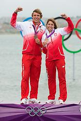 2012 Olympic Games London / Weymouth<br /> RSX Medal Ceremonies<br /> Miarczynski Przemyslaw, (POL, RS:X Men)<br /> Noceti-Klepacka Zofia, (POL, RS:X Women)
