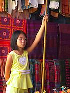 Girl at market stand at Bac Ha