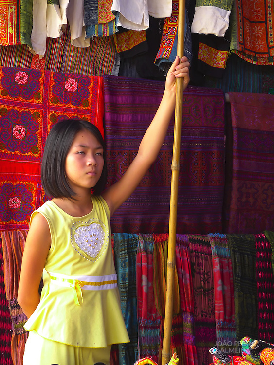 Girl at market stand at Bac Ha