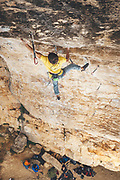 """Climber red pointing """"el celiaco"""" route in Patones, Spain"""