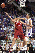 Kansas State forward Marlies Gipson (R) fouls Oklahoma's Laura Andrews (11), as Andrews goes in for a layup, during the first half at Bramlage Coliseum in Manhattan, Kansas, February 21, 2006.  The Wildcats lead at halftime 39-36.