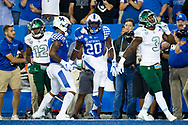 Kentucky Wildcats running back Kavosiey Smoke (20) celebrates a touchdown during the first half at Kroger Field in Lexington, Ky., Saturday, Sept. 7, 2019.