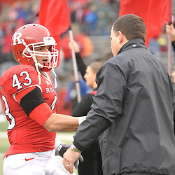 Dec 5, 2009; Piscataway, NJ, USA; Rutgers head coach Greg Schiano shakes hands with cornerback Ramy Nubani during the senior ceremony before first half NCAA Big East college football action between Rutgers and West Virginia at Rutgers Stadium.