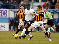 Photo: Leigh Quinnell.<br /> Luton Town v Hull City. Coca Cola Championship. 04/02/2006. Hulls Darryl Duffy challenges Lutons Enoch Showunmi.
