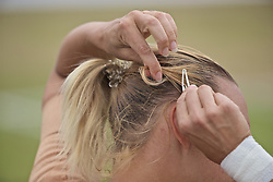 LIVERPOOL, ENGLAND - Sunday, June 23, 2019: Kaia Kanepi (EST) adjusts her hair clips during the Ladies' Final on during Day Four of the Liverpool International Tennis Tournament 2019 at the Liverpool Cricket Club. (Pic by David Rawcliffe/Propaganda)