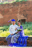 BAGAN, MYANMAR - DECEMBER 02, 2016 : Burmese bride and groom posing with traditional cosutmes in the historic capital city of Bagan Myanmar (Burma)
