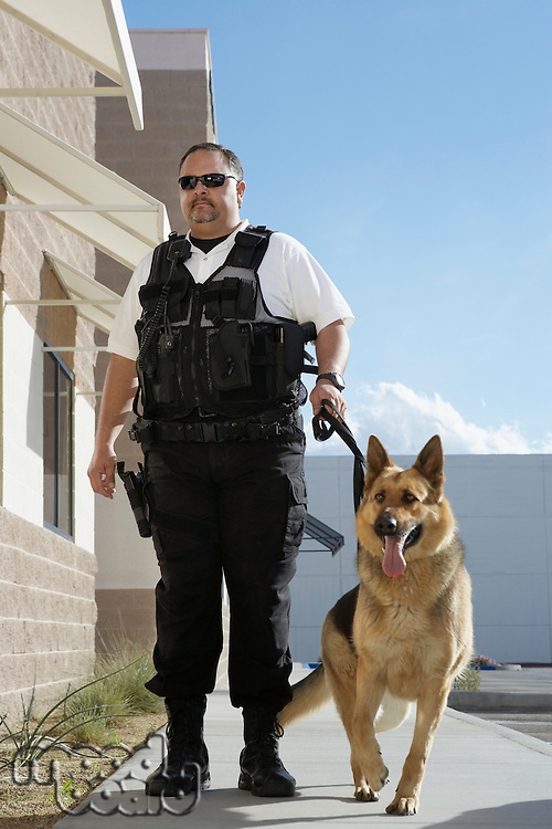 Security guard with dog on patrol