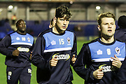 Jake Reeves of AFC Wimbledon holds the ball in front of Michael Raynes of Carlisle United FC during the Sky Bet League 2 match between AFC Wimbledon and Carlisle United at the Cherry Red Records Stadium, Kingston, England on 23 February 2016. Photo by Stuart Butcher.