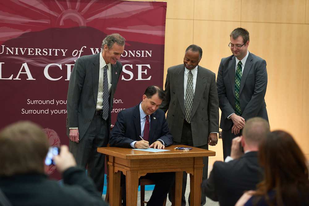 Buildings; Centennial; Location; Inside; Objects; pen pencil marker; People; Chancellor Joe Gow; Spring; March; Type of Photography; Candid; UWL UW-L UW-La Crosse University of Wisconsin-La Crosse; Governor Walker Bill Signing Education interships; Ray Allen Department of Workforce Development; Andrew Evenson legislative liaison