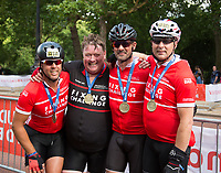 Riders from The Fixing challenge with their medals after completing The London-Surrey100 in Prudential RideLondon on 30th July 2017<br /> <br /> Photo: Paul Gregory/Silverhub for Prudential RideLondon<br /> <br /> Prudential RideLondon is the world's greatest festival of cycling, involving 100,000+ cyclists – from Olympic champions to a free family fun ride - riding in events over closed roads in London and Surrey over the weekend of 28th to 30th July 2017. <br /> <br /> See www.PrudentialRideLondon.co.uk for more.<br /> <br /> For further information: media@londonmarathonevents.co.uk