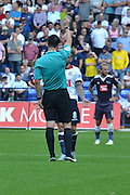 Jay Spearing recieves his first yellow card during the Sky Bet Championship match between Bolton Wanderers and Derby County at the Macron Stadium, Bolton, England on 8 August 2015. Photo by Mark Pollitt.