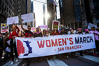 SAN FRANCISCO, CA - JANUARY 20, 2018: San Francisco Assessor-Recorder Carmen Chu (center) helps carry a banner while marching down Market Street towards the Embarcadero, during the Women's March in San Francisco, California on January 20, 2018. (Photo by Philip Pacheco)