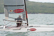 Chris Nicholson (AUS1003), race two of the A Class World championships regatta being sailed at Takapuna in Auckland. 11/2/2014