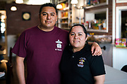 Owners Jose Vasquez and Anahi Rojas pose for a portrait at El Panzon Panaderia in Madison, Wisconsin, Thursday, June 20, 2019.