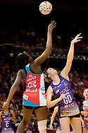 SYDNEY, AUSTRALIA - AUGUST 24: Sam Wallace of the Swifts and Kim Jenner of the Queensland Firebirds go for the ball during the round 14 Super Netball match between the Swifts and the Queensland Firebirds at Qudos Bank Arena on August 24, 2019 in Sydney, Australia.(Photo by Speed Media/Icon Sportswire)