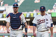 Joe Mauer #7 and Kevin Correia #30 of the Minnesota Twins head toward the dugout before a game against the Chicago White Sox on June 19, 2013 at Target Field in Minneapolis, Minnesota.  The Twins defeated the White Sox 7 to 4.  Photo: Ben Krause