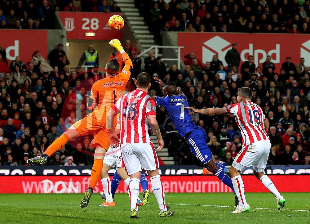 Jack Butland of Stoke City punches the ball away from Ramires of Chelsea  - Mandatory byline: Matt McNulty/JMP - 07966 386802 - 07/11/2015 - FOOTBALL - Britannia Stadium - Stoke-On-Trent, England - Stoke City v Chelsea - Barclays Premier League