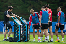 DINARD, FRANCE - Thursday, June 9, 2016: Wales' George Williams  takes a bottle from a Powerade drinks dispenser during a training session at their base in Dinard during the UEFA Euro 2016 Championship.  Dr Rhodri Martin (Pic by Paul Greenwood/Propaganda)
