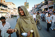 A begga r in the street in Delhi,  India