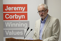 © Licensed to London News Pictures. 24/08/2016. London, UK. Labour party leader Jeremy Corbyn speaks on the NHS. Mr Corbyn faces increasing criticism after appearingng in a video sitting on the floor of a crowded train.  Virgin trains owner Sir Richard Branson released cctv footage appearing to show that seats were available. Photo credit: Peter Macdiarmid/LNP